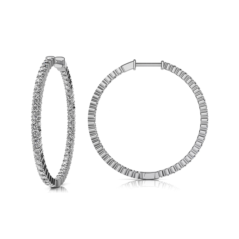14 Karat white gold and diamond inside out hinged hoop earring.