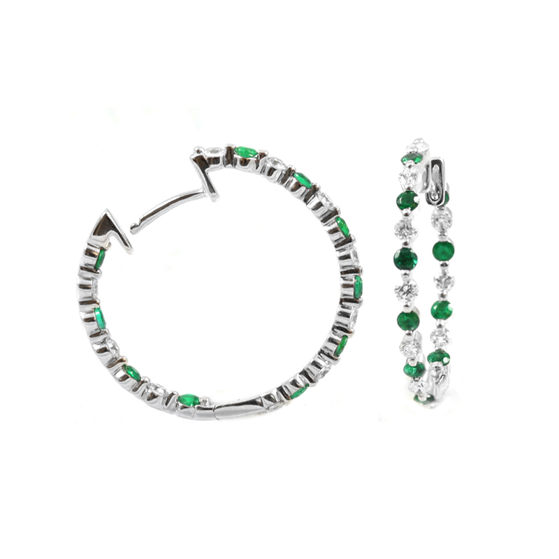 14 Karat white gold, diamond and emerald inside out hinged hoop earrings.