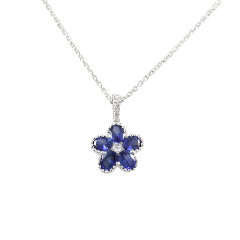 18karat white gold sapphire and diamond flower pendant.