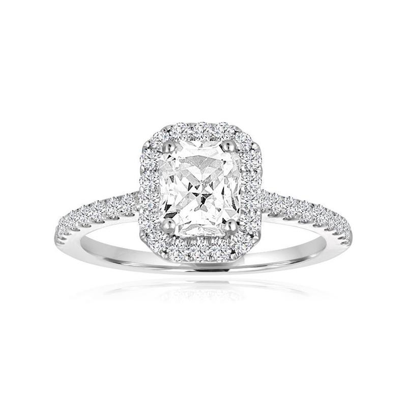 14 Karat white gold and emerald cut center diamond semi mount ring.
