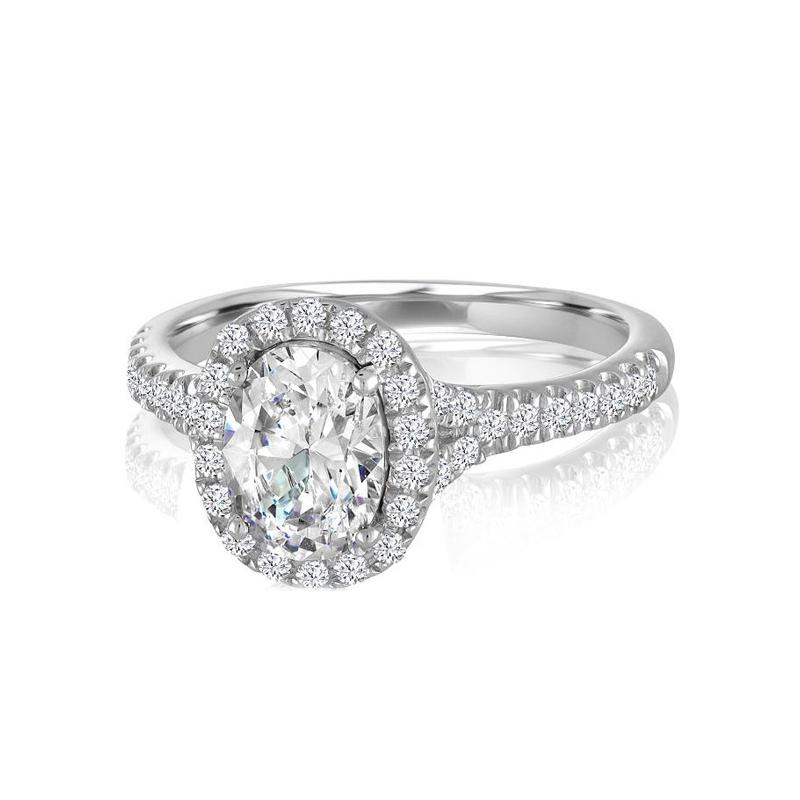 14 Karat white gold and oval center diamond semi mount ring.