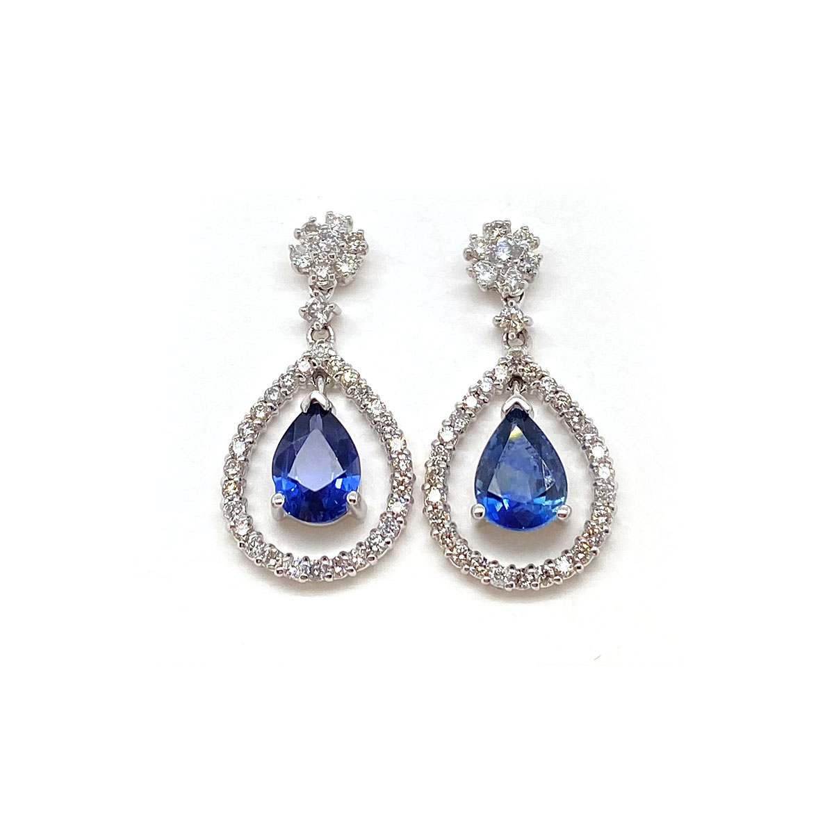 14 Karat White Gold Pear Shaped Blue Topaz and Diamond Dangle Earrings