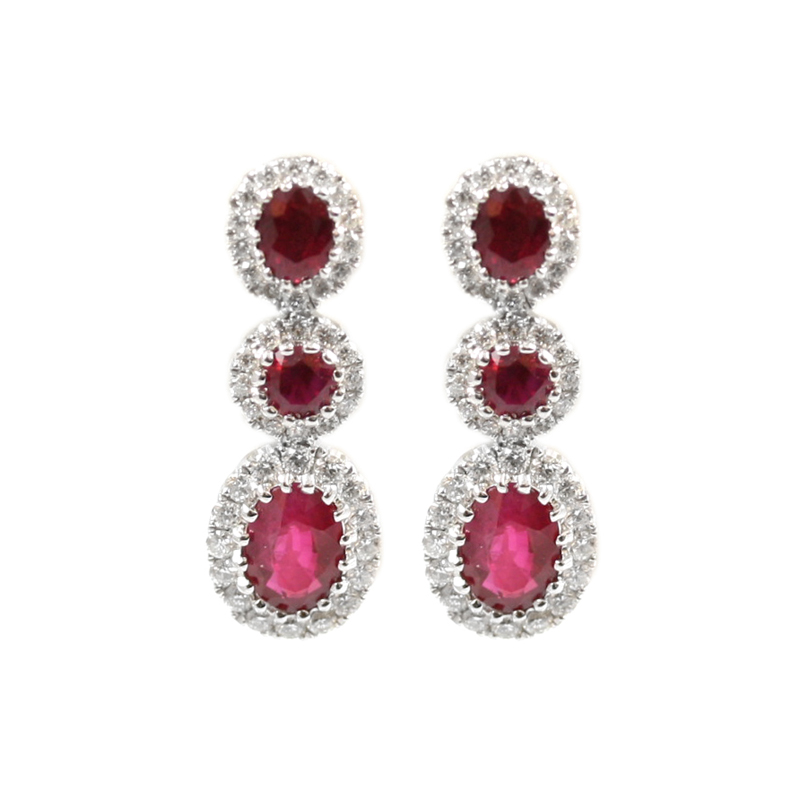 14 Karat white gold hinged ruby and diamond earrings.
