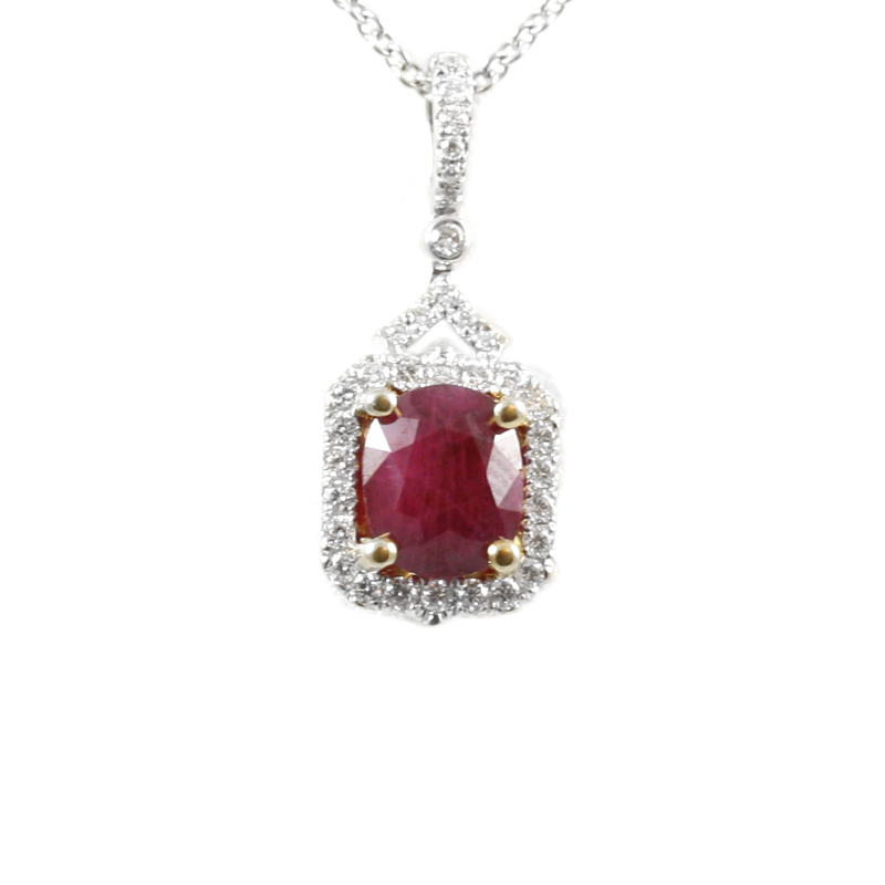 14 Karat yellow gold diamond and ruby pendant suspendent on a 16 inches oval link chains with lobster clasp.