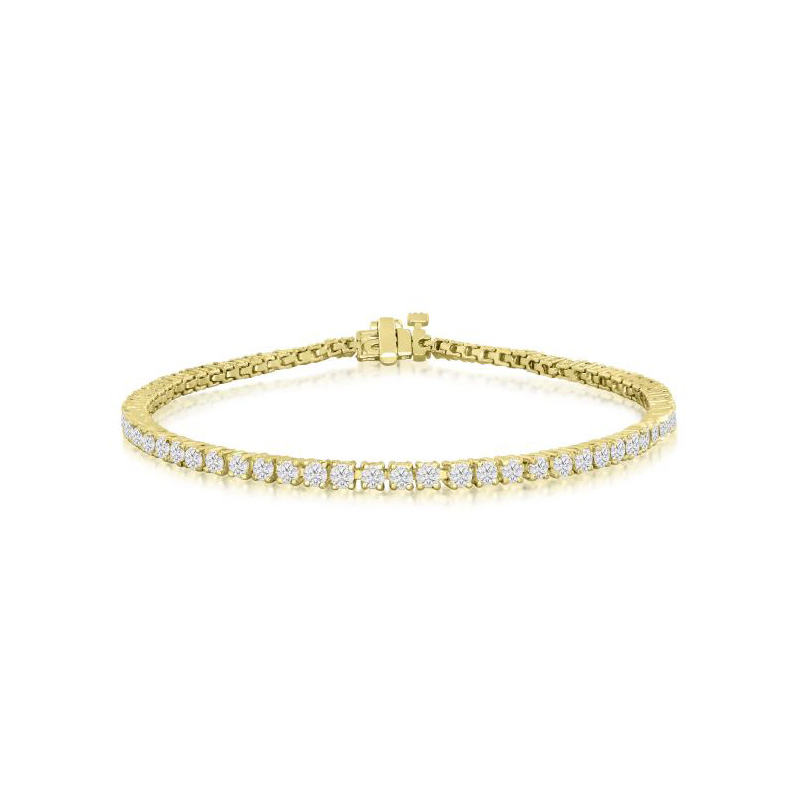 "18 Karat yellow gold and diamond tennis bracelet measuring 7"" long. 3 cttw."