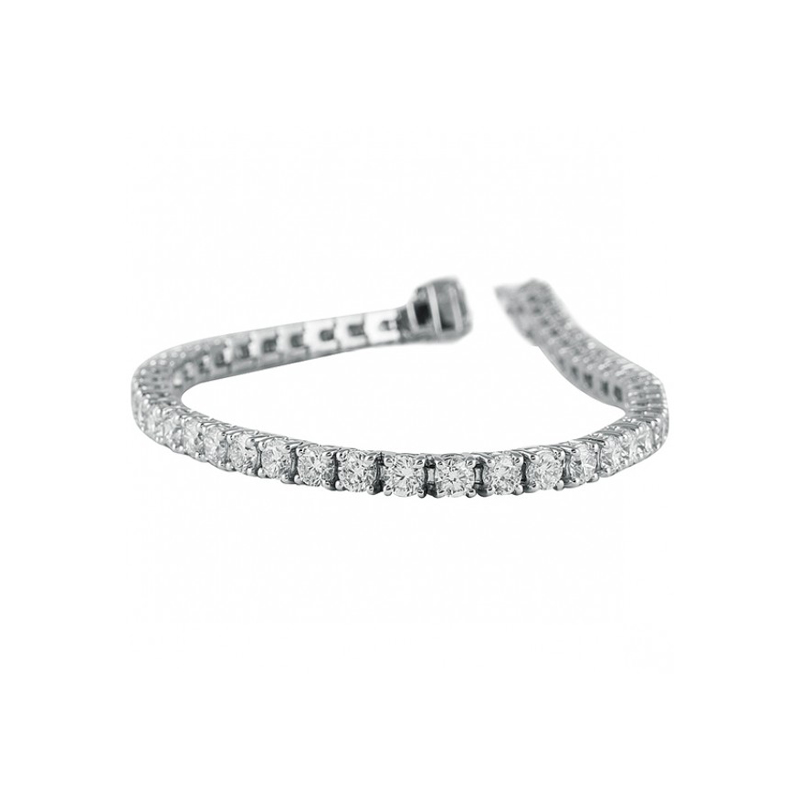 "18 Karat White gold and diamond tennis bracelet measuring 7"" long. 7 cttw."