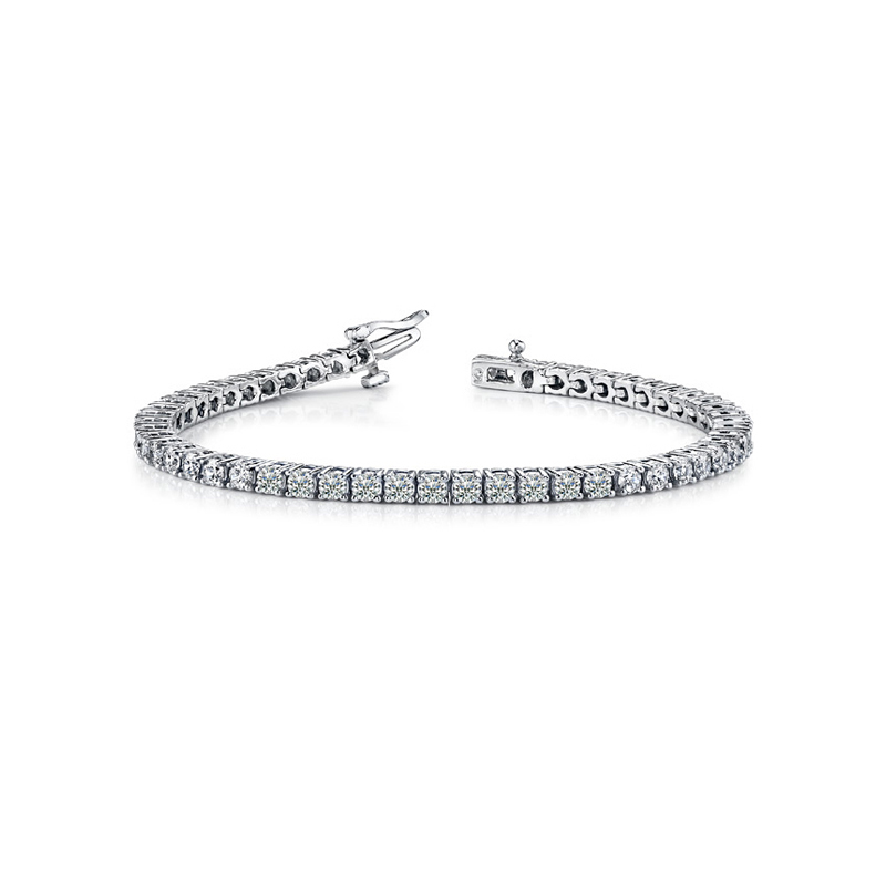 "14 Karat White gold and diamond tennis bracelet measuring 7"" long. 7 cttw."