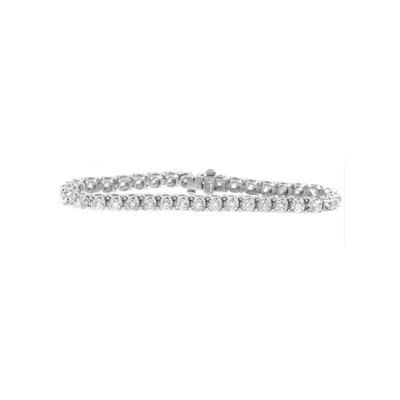 "18 Karat White gold and diamond tennis bracelet measuring 7"" long. 6.71 cttw."