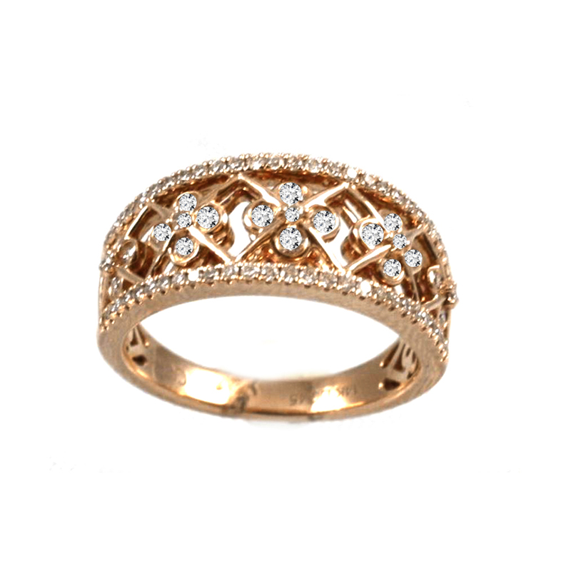 Gregg Ruth 14 Karat rose gold and diamond ring.
