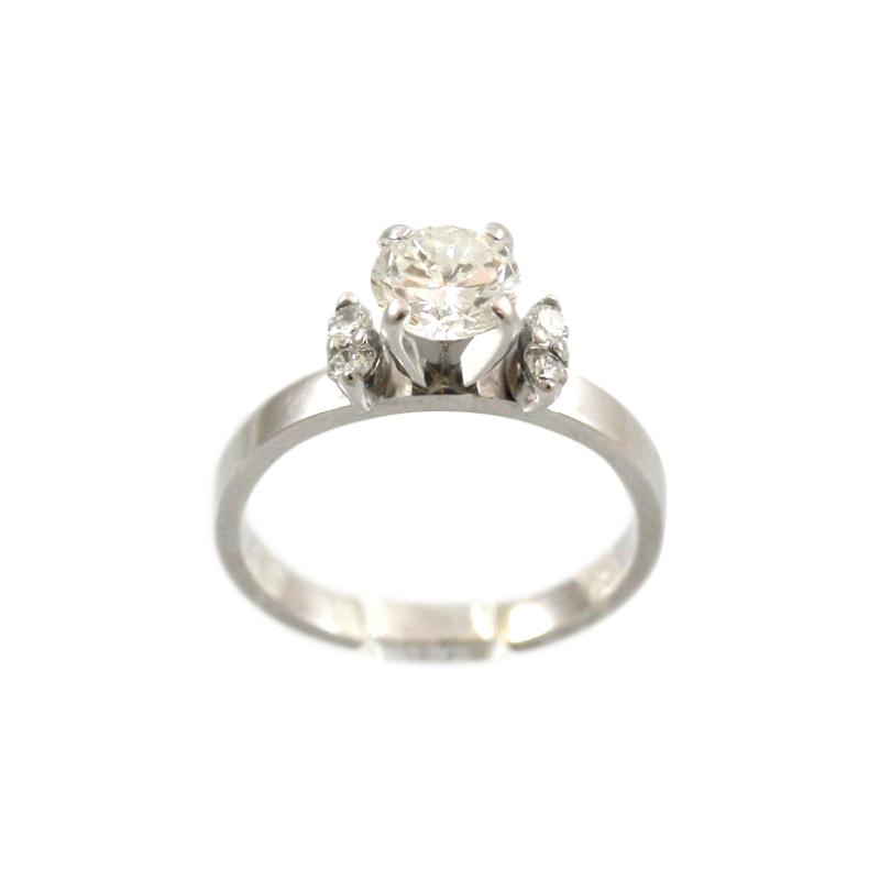 This Lovely 14 Karat White Gold Diamond Bridal Ring Has One Round Brilliant Diamond Prong Set In The Center With Two Full Cut Diamonds Prong Set On Either Side.