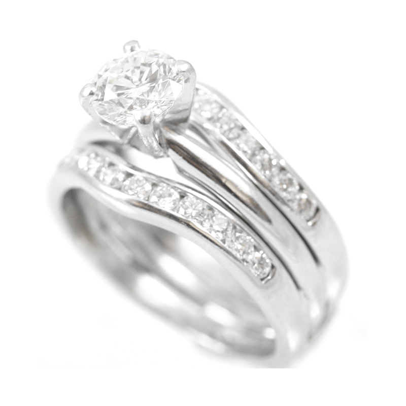 Estate 14 Karat white gold, diamond solitaire engagement ring with soldered jacket.