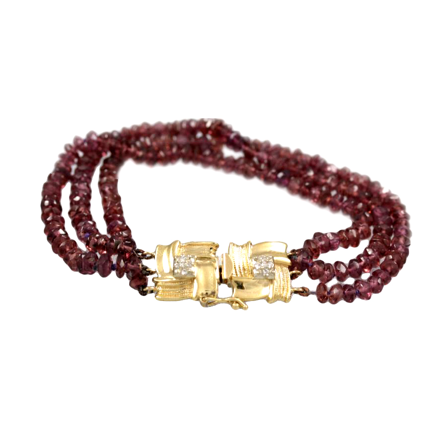Estate 14 Karat Yellow Gold Three Strand Ruby and Diamond Bracelet.