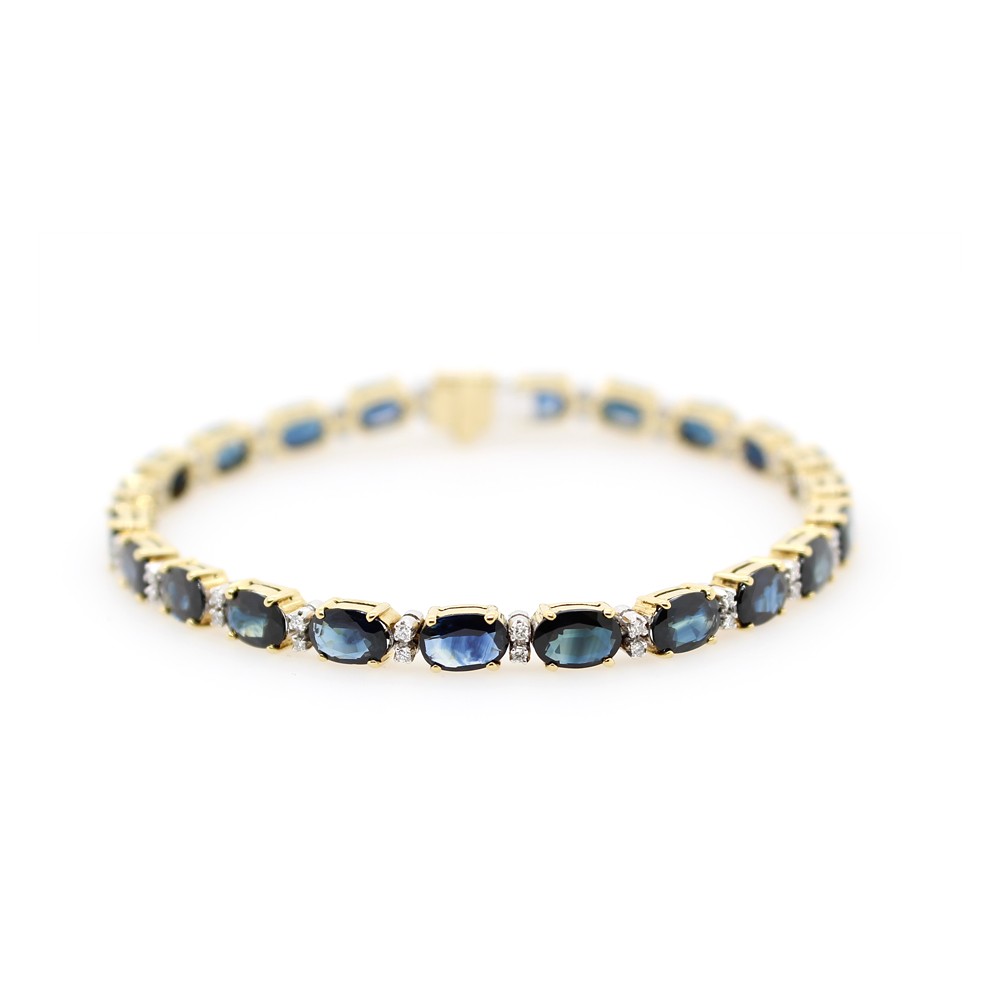 Estate 18 Karat Yellow and White Gold Blue Sapphire and Diamond Bracelet