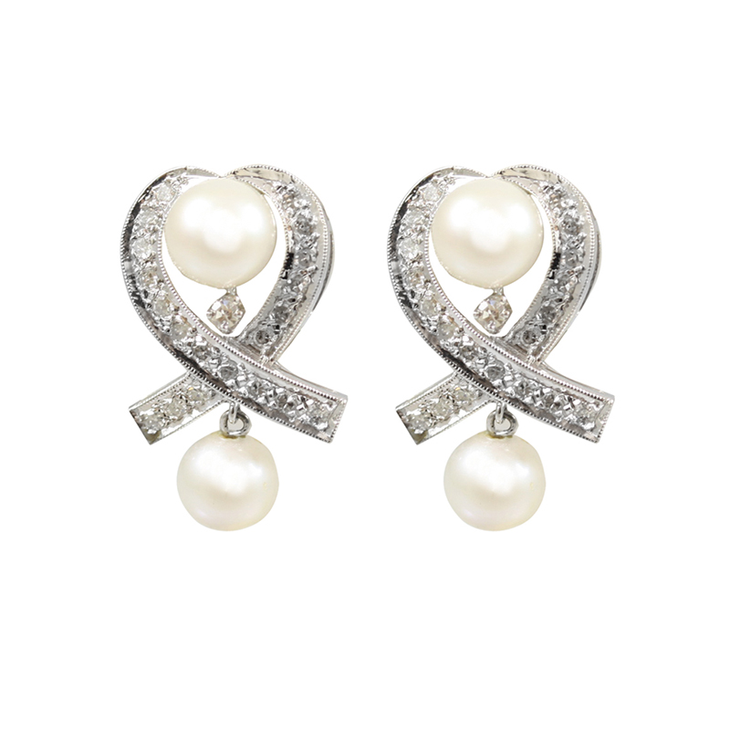 These Elegant White Gold Diamond And Pearl Earrings Create A Strong Statement.