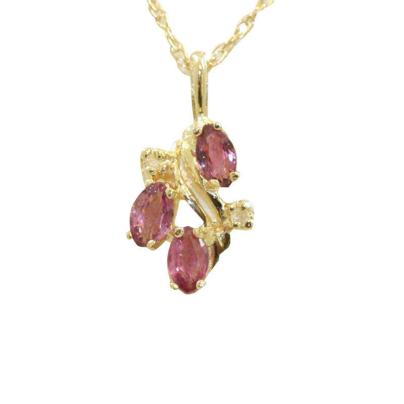 "Vintage 14 Karat yellow gold diamond and ruby suspended on a 18"" wheat chain with a spring ring clasp."