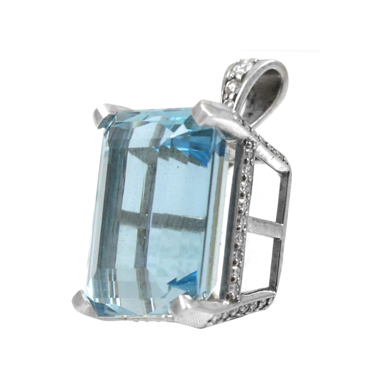 Vintage 14 Karat white gold, aquamarine and diamond pendant.