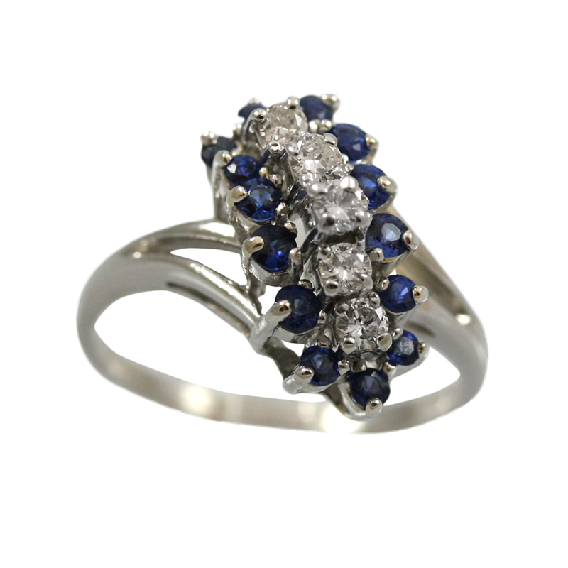 This 14 Karat Gold Sapphire And Diamond Ring Is Elegant With A Unique Style.