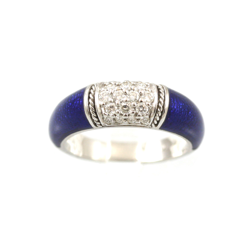 This Hidalgo 18Karat White Gold Blue Enamel Diamond Ring Makes A Strong Statement With Eighteen Prong Set Diamonds In A Five Row Center Framed With Two Bars With A Narrow Rope Between Having A Blue Enamel On Either Side.