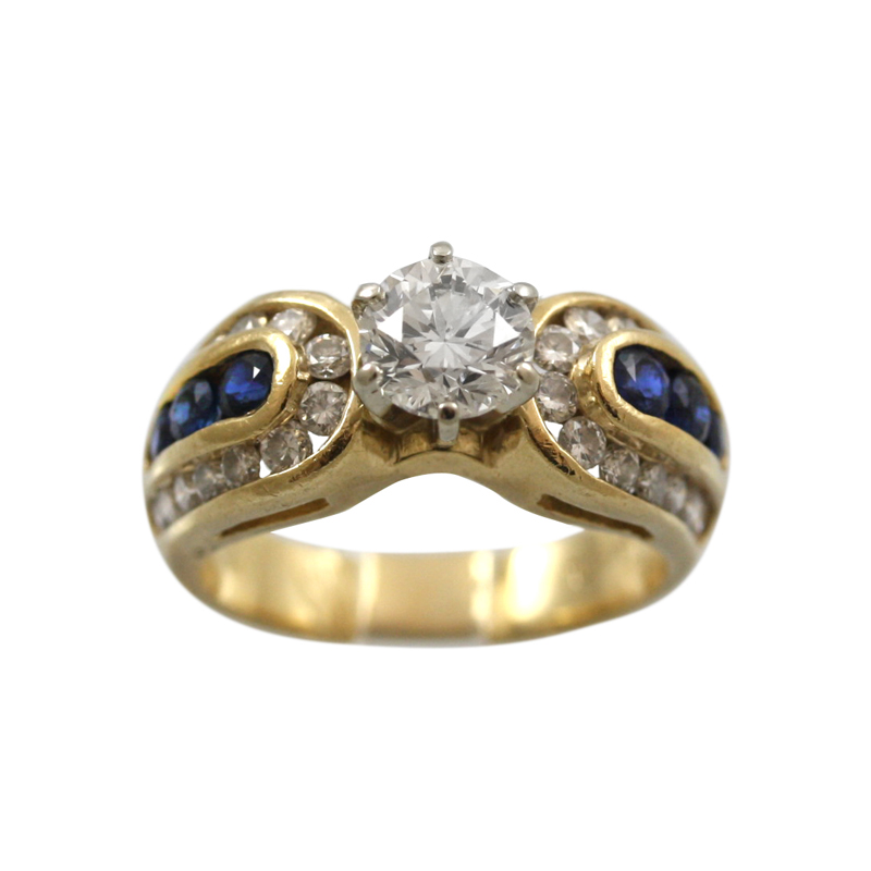 This 14Karat Yellow Gold Diamond And Sapphire Ring Is Elegant Feminine And Unique.