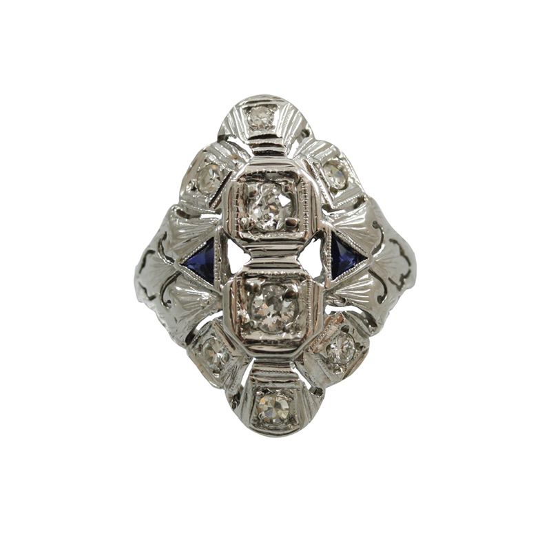 This 18Karat White Gold Diamond And Sapphire Ring Is Shiny Stylish And A Unique Design That Embellishes Marquise Shape.