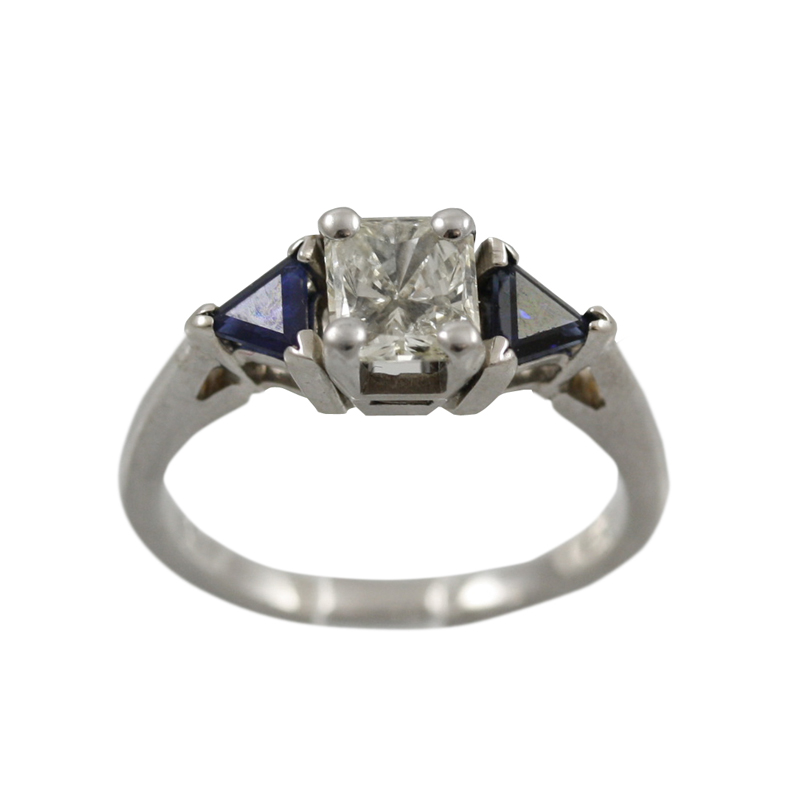 This 14 Karat White Gold Sapphire And Diamond Ring Is An Attention Getter.