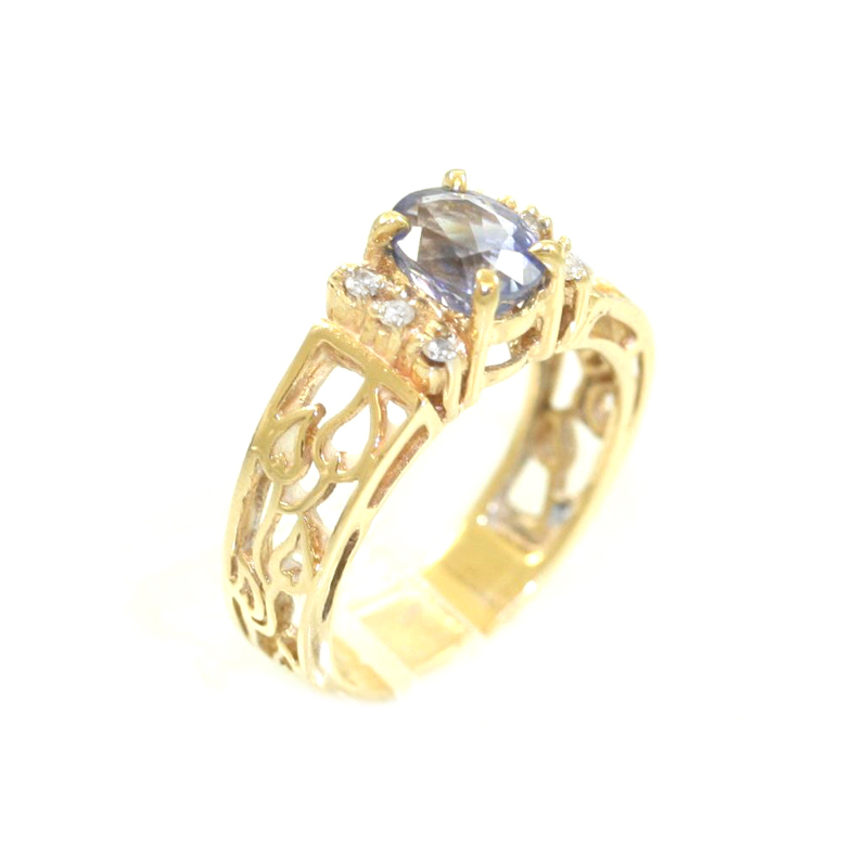 Estate 14 Karat yellow gold, diamond and sapphire ring.