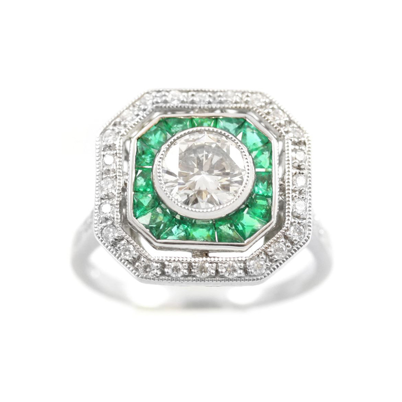 Vintage Platinum, diamond and emerald ring.