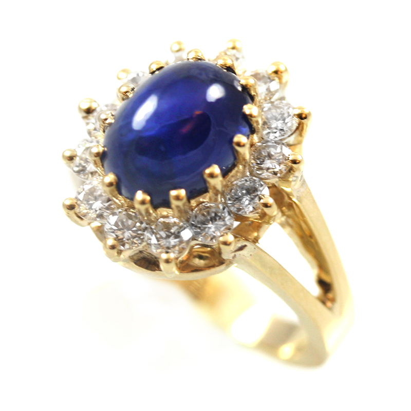 Kamsly Estate 14 karat yellow gold diamond and sapphire ring.