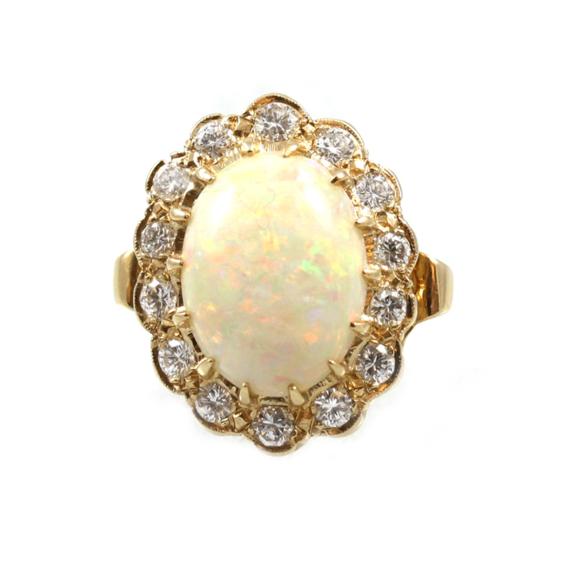 Estate 14 Karat yellow gold, oval opal and diamond ring.