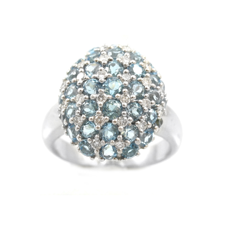 Vintage 14 Karat white gold, diamond and blue topaz oval ring.