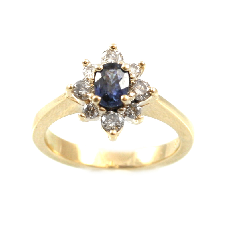 Estate 14 Karat yellow gold, blue sapphire and diamond ring.