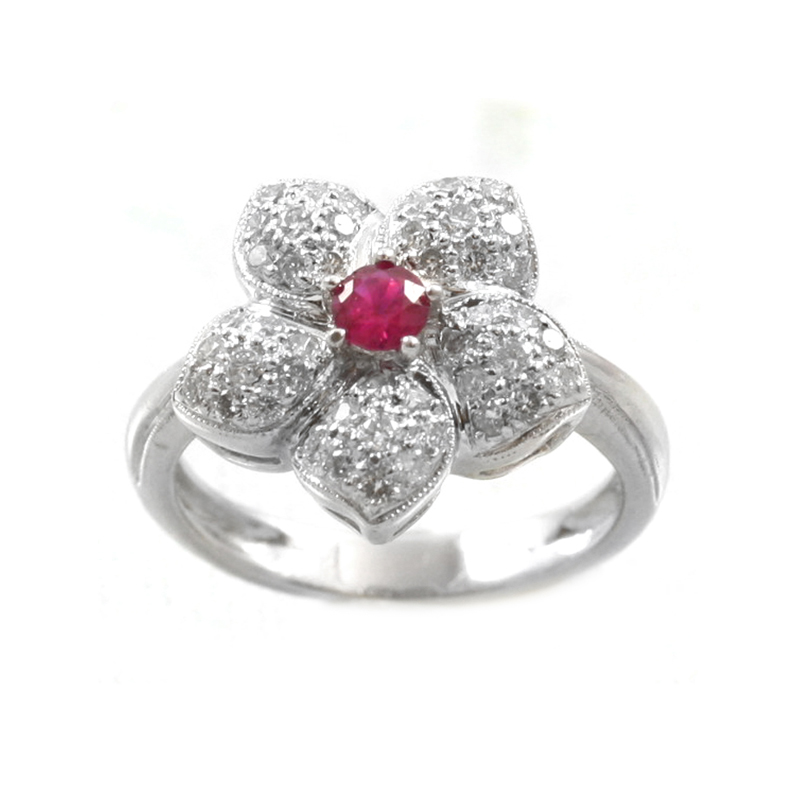 Vintage 18 karat white gold, ruby and diamond flower ring.