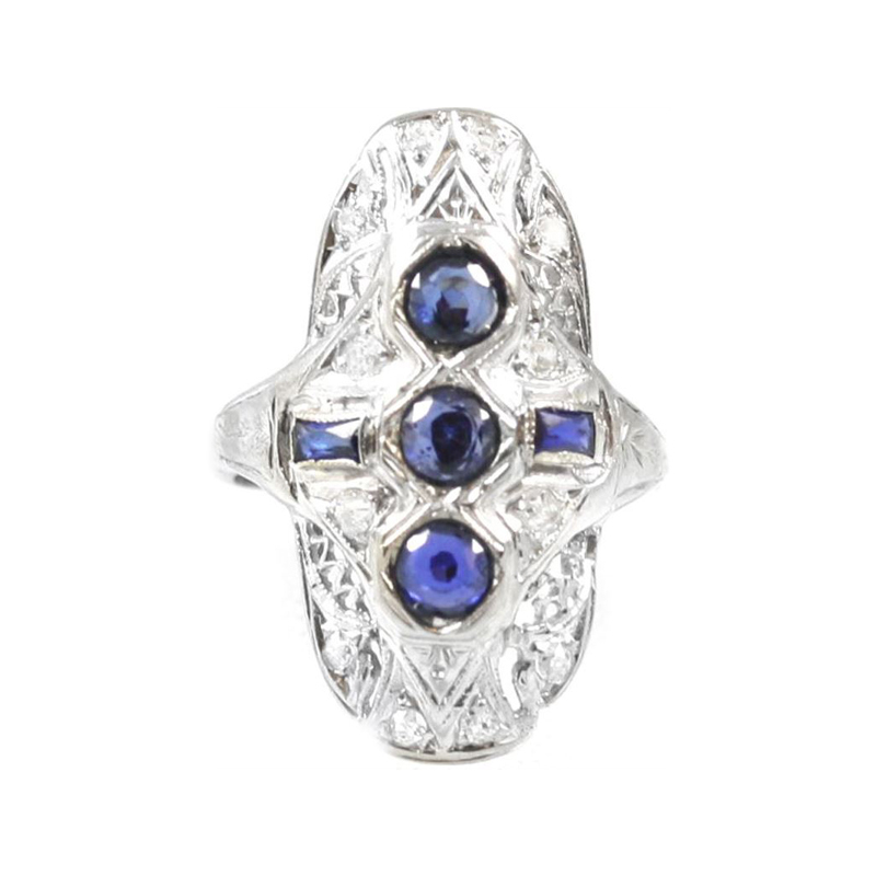 Vintage 18 Karat white gold filigree sapphire and diamond ring.