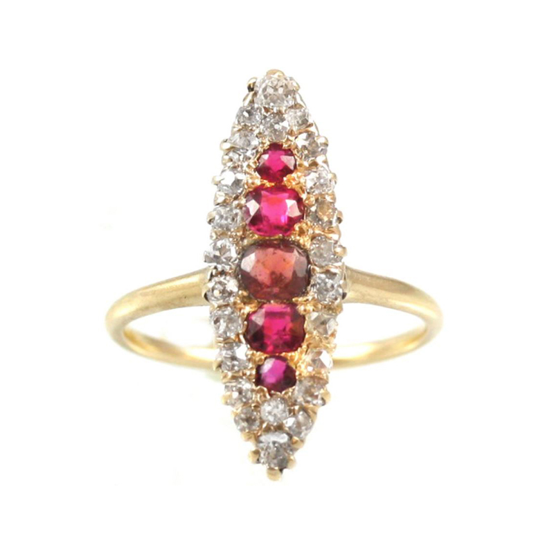 Vintage 14 Karat yellow gold, ruby and diamond navette marquise shaped ring.