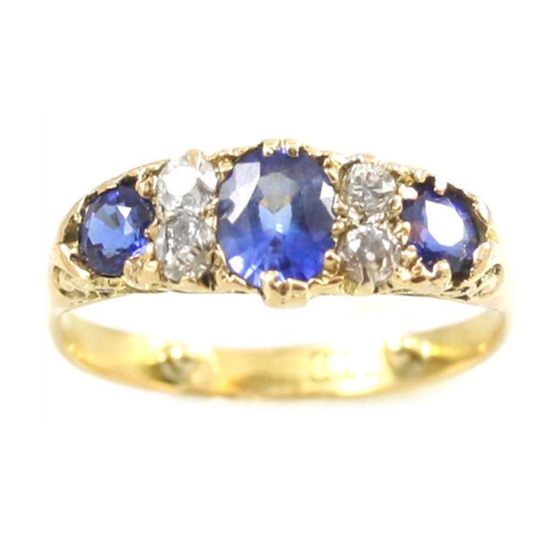 Estate 18 Karat yellow gold, sapphire and diamond band.