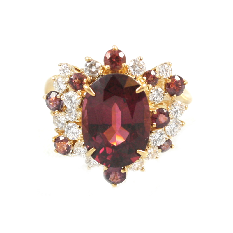 Estate 18 Karat yellow gold, garnet and diamond ring