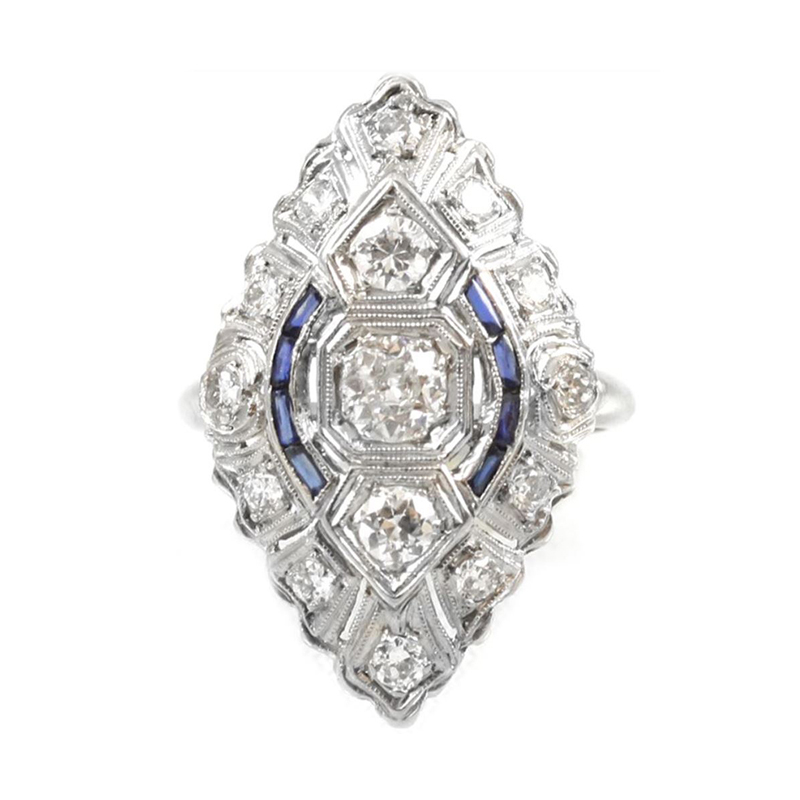 Estate platinum, diamond and blue sapphire ring.
