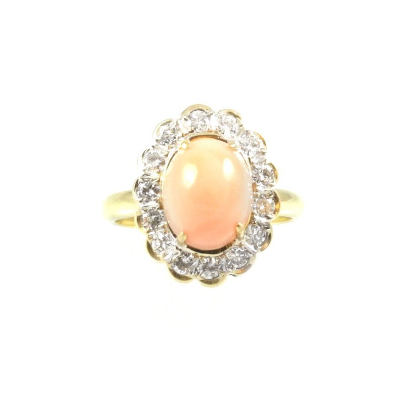 Estate 14 Karat yellow gold, coral and diamond ring.