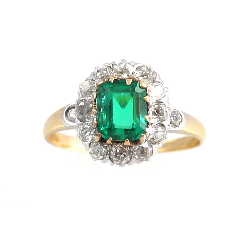 Estate 14 Karat yellow gold, emerald and diamond ring.