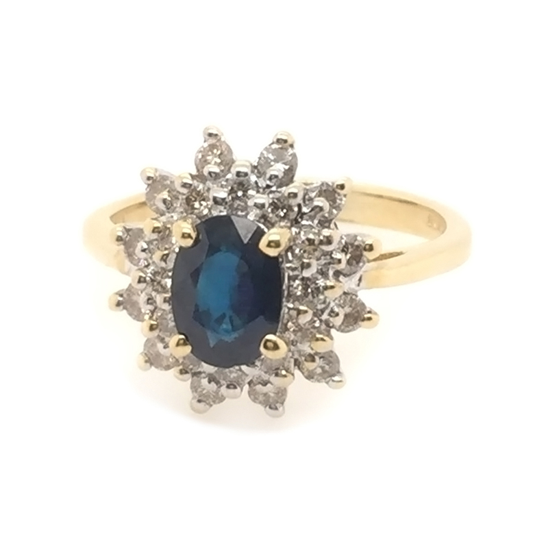 Estate 14 Karat yellow gold, blue sapphire and diamond ring