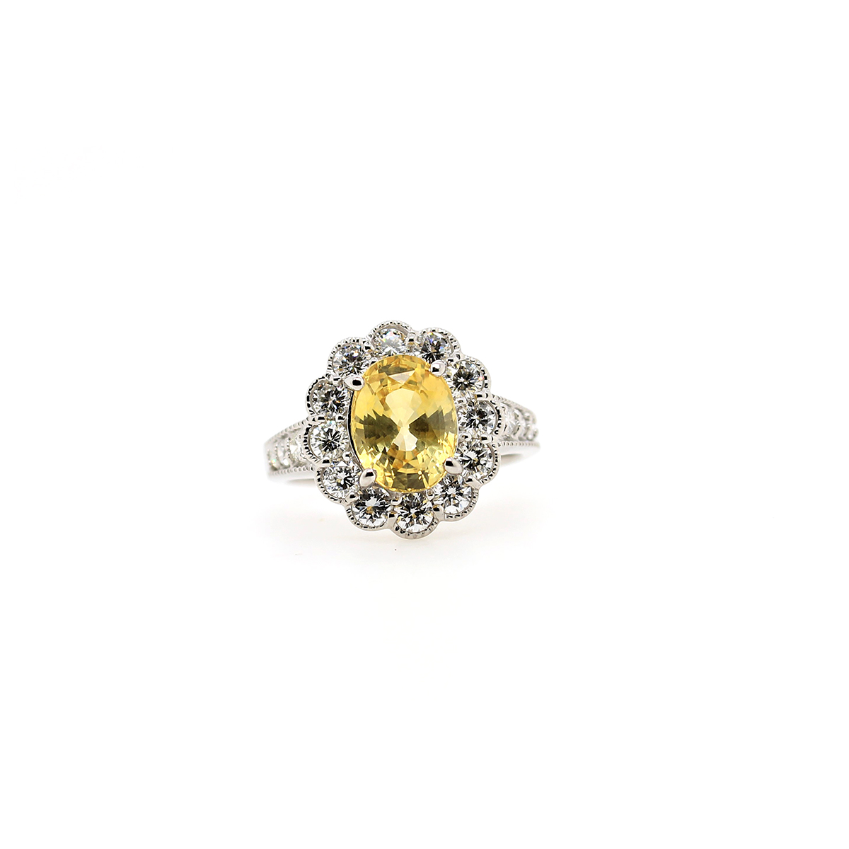 Vintage Platinum Oval Yellow Sapphire and diamond Ring