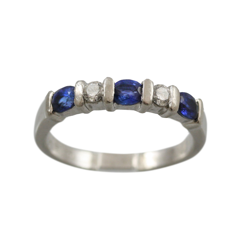 This Beautiful Platinum Diamond And Sapphire Band Makes An Elegant Statement.