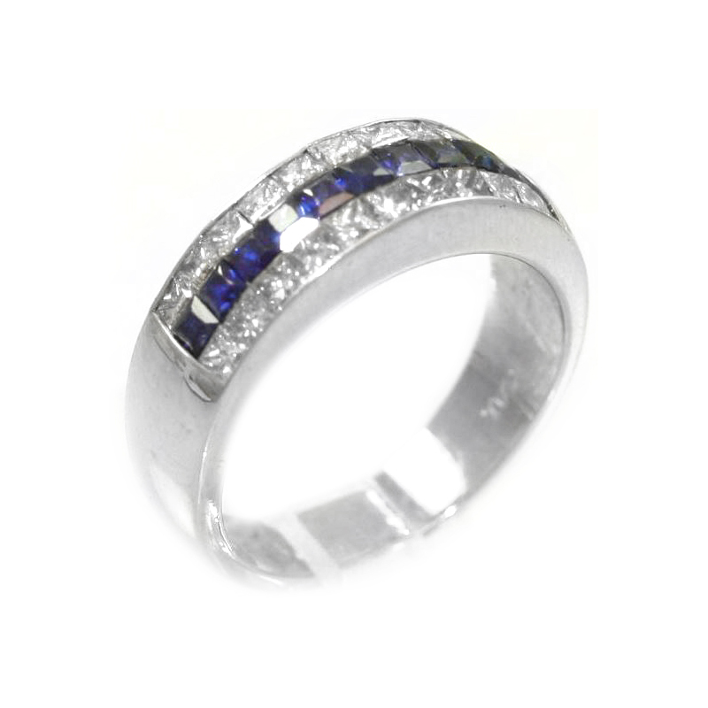 Estate platinum, diamond and sapphire ring The ring contains one center row of 11 square sapphires bezel set with 2 rows of 11 princes cut diamonds bezel set on either side.