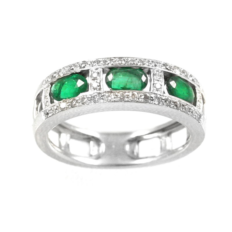 Vintage 14 Karat white gold, emerald, and diamond band.