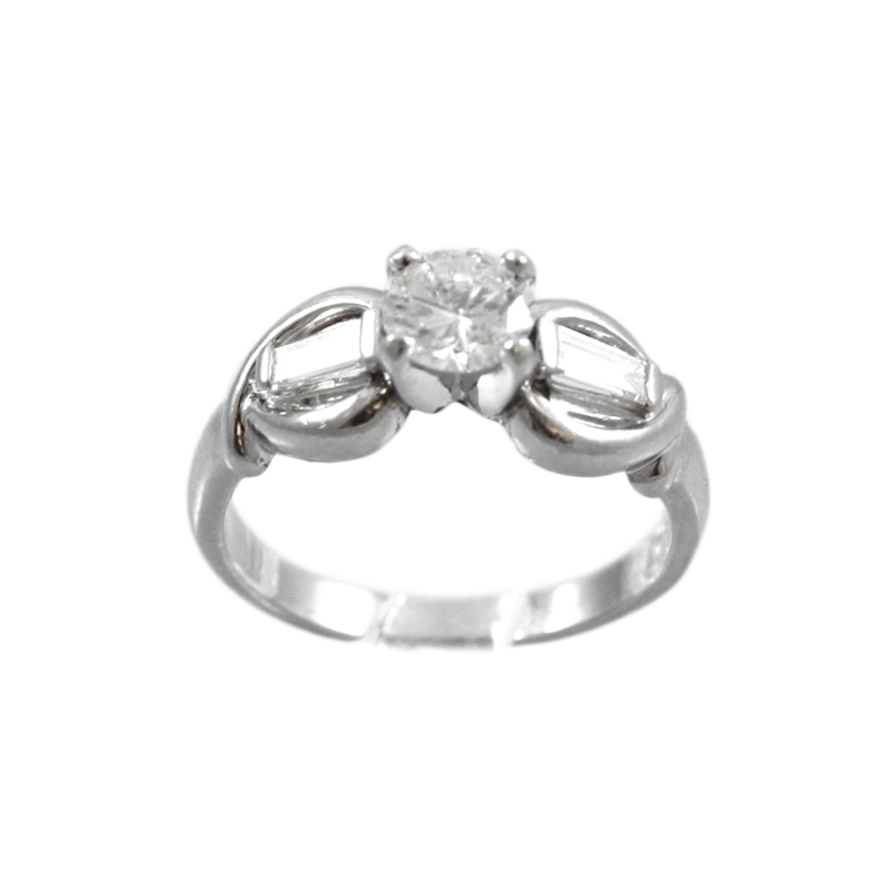 Classically Tailored Platinum And Diamond Ring.