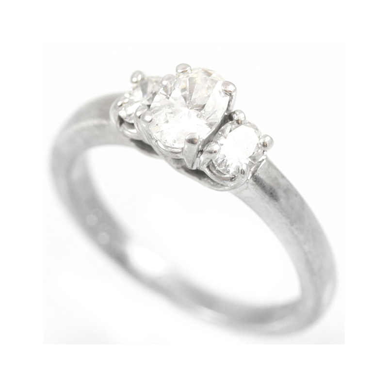 Estate 14 Karat white gold and oval diamond ring.