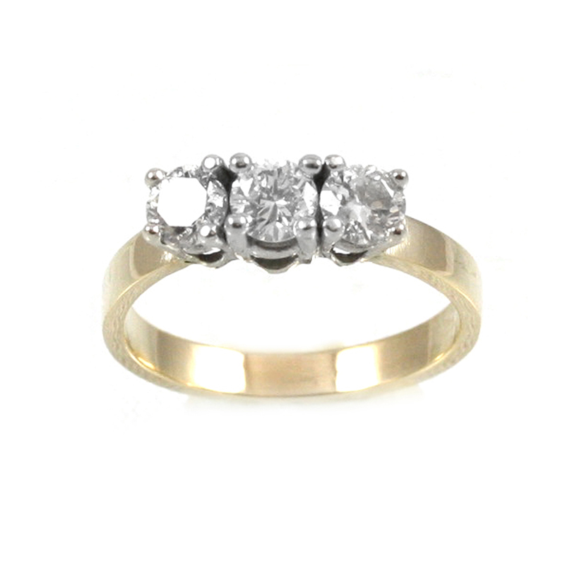 Estate 14 Karat yellow and white gold 3 across diamond ring.
