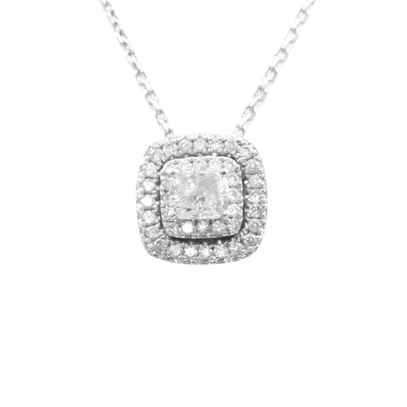 "Vintage 14 Karat white gold and diamond halo pendant suspended on a 16 to 18"" long chain."