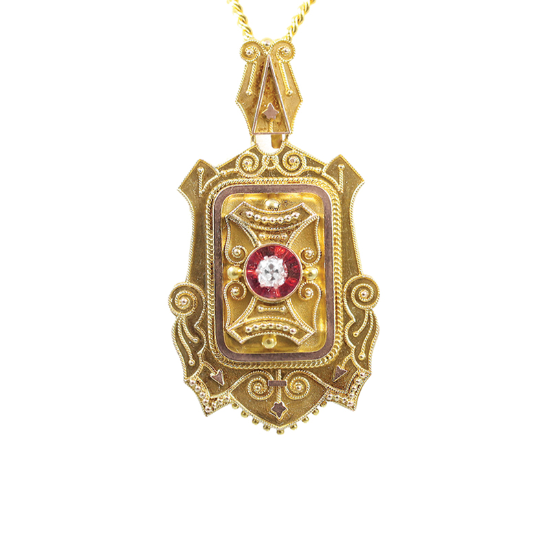 Vintage 18 Karat white gold, 22 karat yellow gold plating and rose cut diamond Victorian locket.