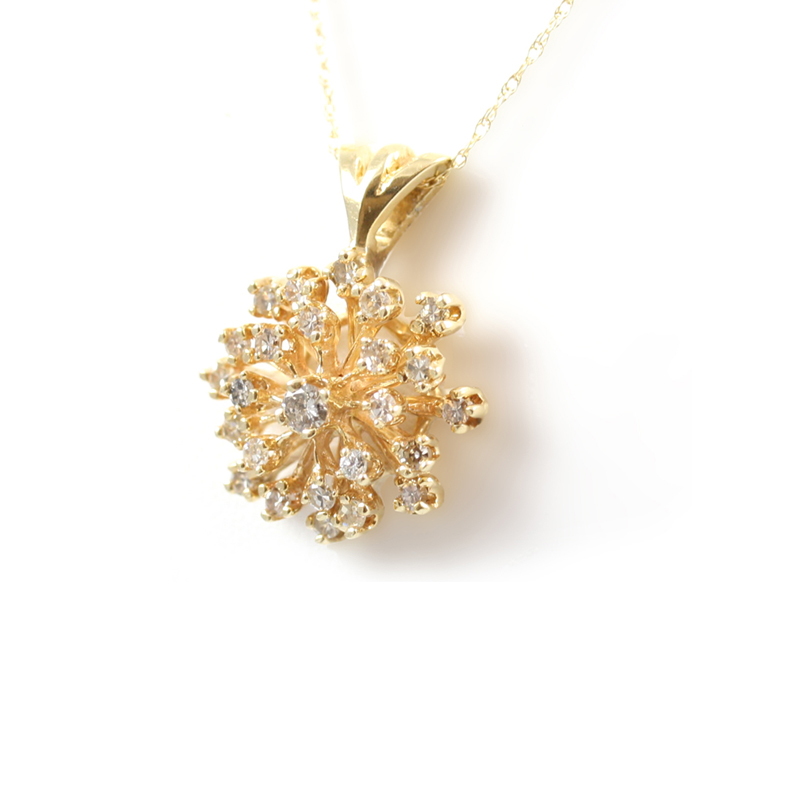 Vintage 14 karat yellow gold diamond cluster pendant.